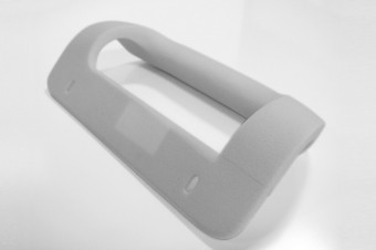 A foam model of one of the first variants of the entry-level door handle.