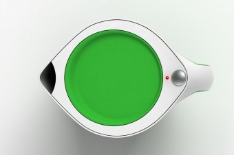 The bright green lid contrasts strongly with the iconic white of the kettle.